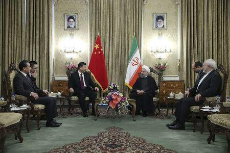 Iranian President Hassan Rouhani meets Chinese President Xi Jinping in Tehran, Iran January 23, 2016. REUTERS/President.ir/Handout via Reuters