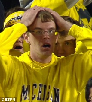2d83fcd000000578-3282196-the_face_that_says_it_all_this_michigan_fan_looked_horrified_as_-a-4_1445398510133